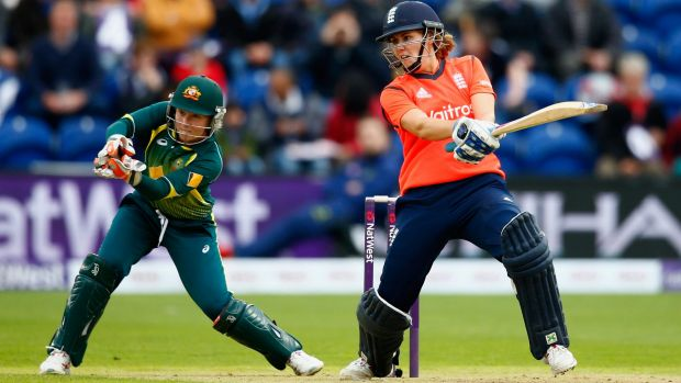 Player of the match, Natalie Sciver of England, cuts as Australian wicketkeeper Alyssa Healy looks on.