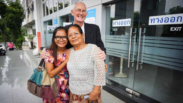 Alan Morison and Chutima Sidasathian with Chutima's mother after their acquittal in Phuket in September.