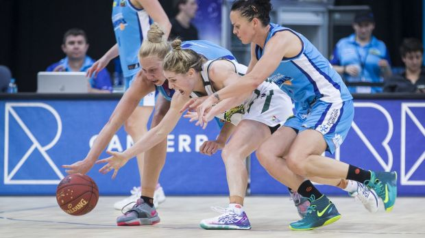 Canberra Capitals recruit Kathleen MacLeod - sandwiched by former Caps players Abby Bishop and Kristen Veal - is in ...