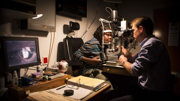 An Indigenous woman has her eyes examined at Alice Springs Base Hospital.