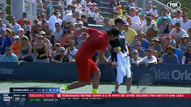 Thanasi Kokkinakis throws his racquet into the ground in frustration after cramp foiled a potential upset of Richard Gasquet.