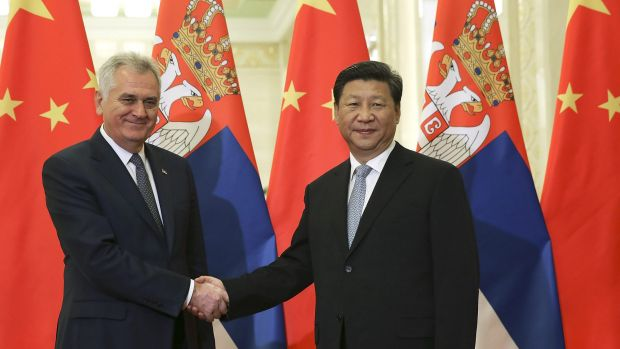 Serbian President Tomislav Nikolic, left, poses with Chinese President Xi Jinping in the Great Hall of the People in Beijing.