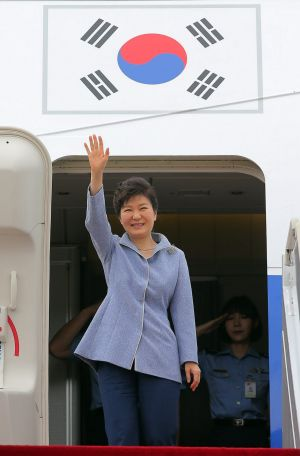 South Korean President Park Geun-hye waves before leaving for China from Seoul Military Airport in Seongnam, South ...