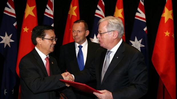 Chinese Commerce Minister Gao Hucheng, former prime minister Tony Abbott and then trade minister Andrew Robb at the ...