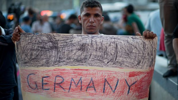 A migrant protests outside Keleti station in central Budapest.