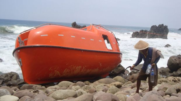 A lifeboat stranded on  Karangjambe beach in Kebumen, Indonesia, after asylum seekers were towed back by Australian ...