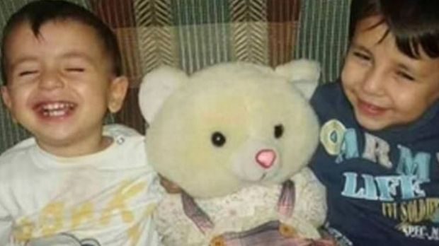 Aylan Kurdi, left, with his brother Galip.