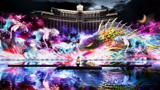 A koi carp hologram is projected onto a water screen behind a Japanese Kabuki dancer at a Las Vegas casino.