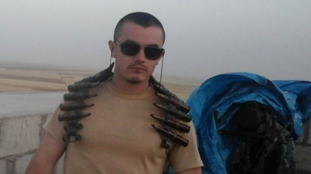 Ashley Dyball photographed on the front line in Syria.