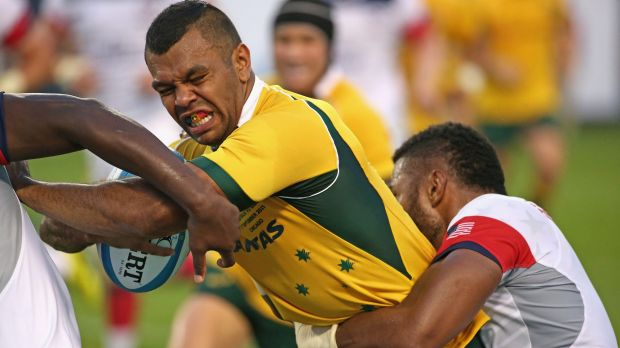 Tough going: Kurtley Beale is tackled by the US defence.