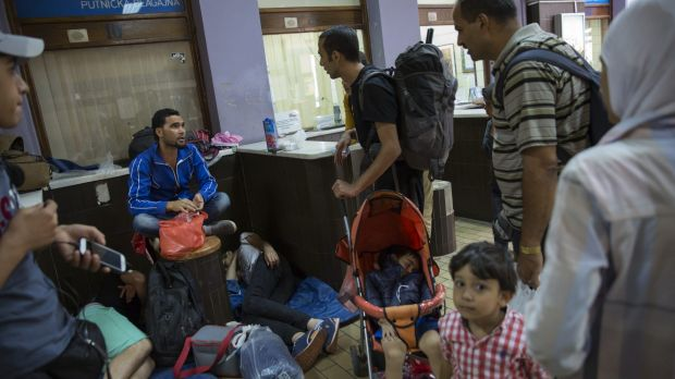 Migrant families gather in the main train station in Belgrade, Serbia.