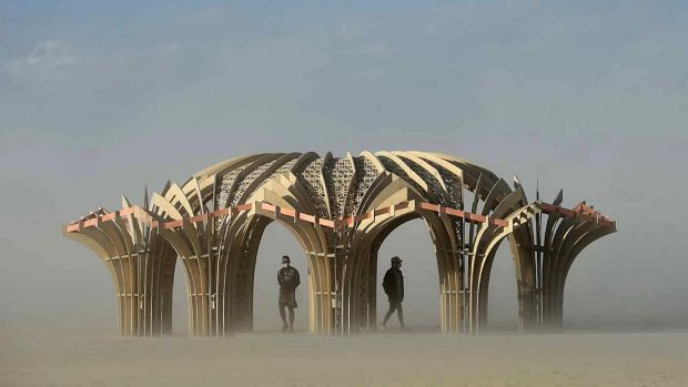 """Burners"" inside a sculpture during a dust storm at Burning Man in Nevada"
