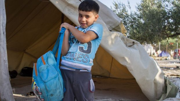 Omran, 6, fled Syria with his family carrying only this bag.