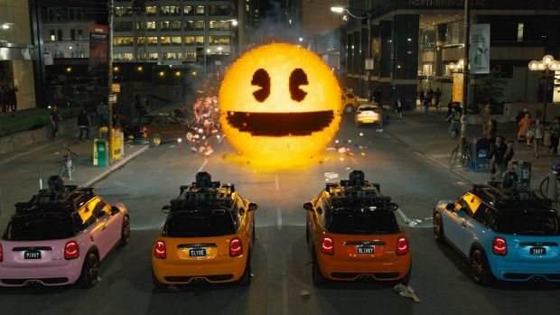 Inky, Blinky, Clyde and Pinky take on Pac-Man in <i>Pixels</i>.
