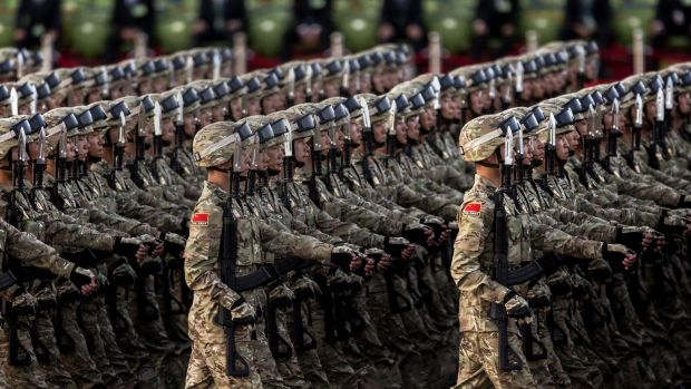 Chinese soldiers march past Tiananmen Square before the military parade.