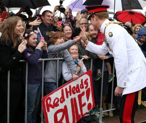 Prince Harry, one of the best known modern-day redheads shares a high five with Ethan Toscan, 12, from Bruce.
