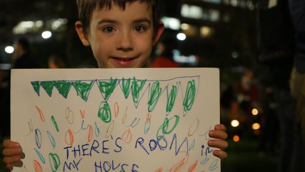 """""""There's room in my house"""" says a sign held by Xavier, who is just two years older than Aylan Kurdi, at the Light the ..."""