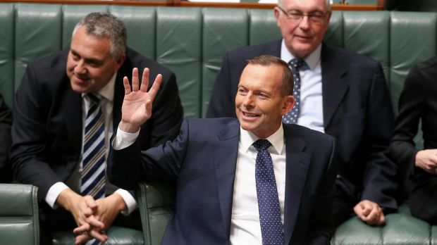 Mr Abbott waves at the public gallery during question time.