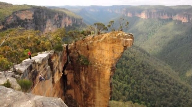 People swing from Hanging Rock in the Blue Mountains in 2011