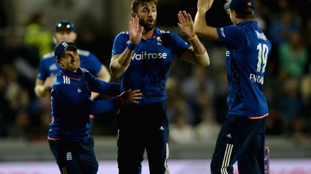 Too easy: Liam Plunkett celebrates with James Taylor and Chris Woakes after dismissing Pat Cummins.