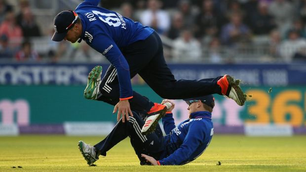 Falling over each other: Eoin Morgan narrowly avoids Jason Roy.