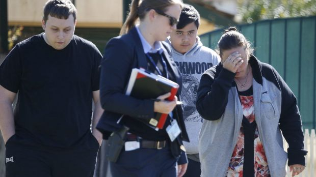 Friends and relatives react to the news of the double murder in Lalor Park.