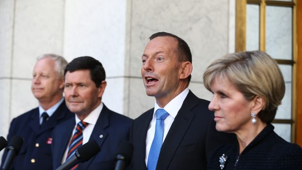 Flanked by Chief of the Defence Force  Mark Binskin, left, Defence Minister Kevin Andrews, and Foreign Affairs Minister ...