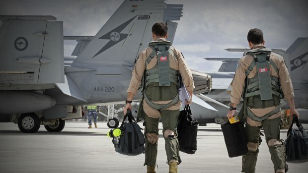 F/A-18F Super Hornet aircrew head to their aircraft in preparation for departure to the Middle East.