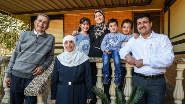 Syrian refugee Anwar Rostom (right) with his parents, wife and children. The family arrived in Australia last year.