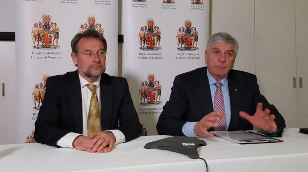 Royal Australasian College of Surgeons president David Watters, left, and Rob Knowles, chairman of the college's expert ...