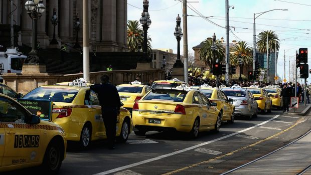 Taxis block the road outside the Victorian Parilaiment.