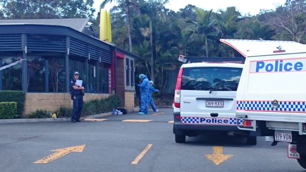 Police investigate the Helensvale McDonald's restaurant where a woman was shot dead.