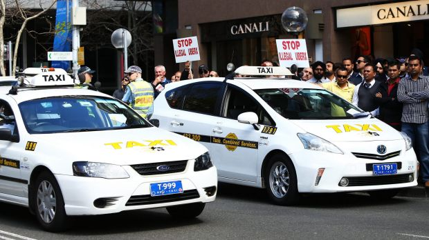 Taxi drivers protest against Uber at the NSW State Parliament this month.
