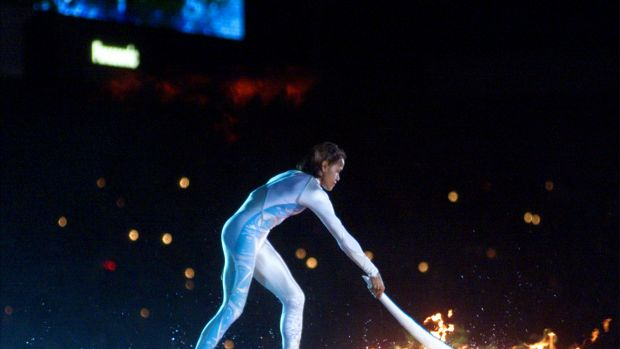 The night the world came to Sydney: Cathy Freeman lights the Olympic cauldron during the Opening Ceremony.