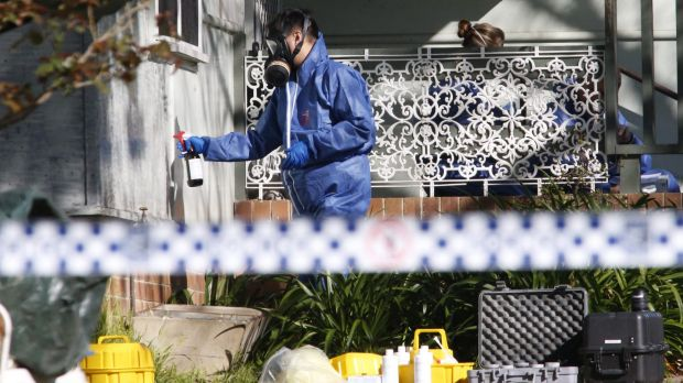 Forensic officers at Linda Adams' home in Lalor Park in 2015.