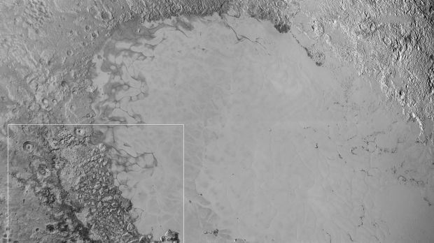 Mosaic of high-resolution images of Pluto, transmitted by NASA's New Horizons spacecraft. The white rectangles indicate ...