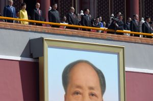 Over the watchful eyes of Mao: Xi Jinping, Park Geun-hye and Vladimir Putin review the troops.