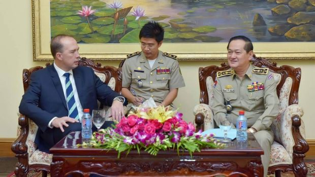 Peter Dutton (left) and Sok Phal (right) meet in Phnom Penh.