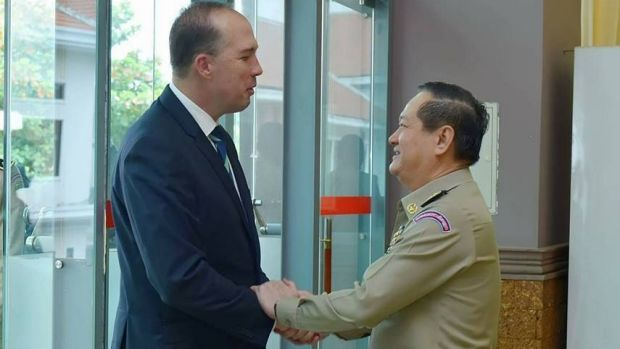 Australian Immigration Minister Peter Dutton and Cambodian Department of Immigration director-general Sok Phal shake ...