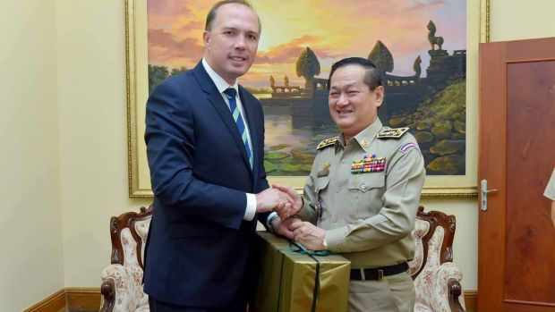 Australian Immigration Minister Peter Dutton presents an Akubra hat to Cambodia's Department of Immigration ...