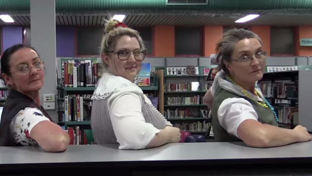 The librarians raided the library's lost property to find glasses to wear in the clip.