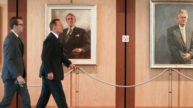 Prime Minister Tony Abbott heads to a meeting in Parliament House on Friday.