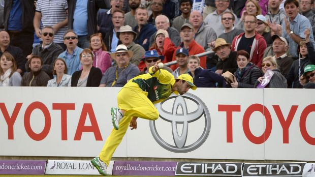 Classic catch ... Glenn Maxwell flings the ball up in the air before stepping over the boundary line as he took a catch ...