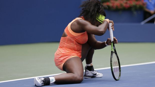Down and out: Serena Williams reacts after losing a point to Roberta Vinci.