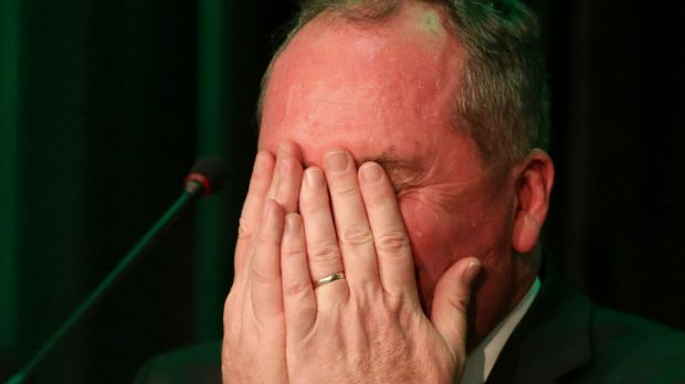 Agriculture Minister Barnaby Joyce reacts as Deputy Prime Minister Warren Truss speaks about the dogs, Pistol and Boo. ...