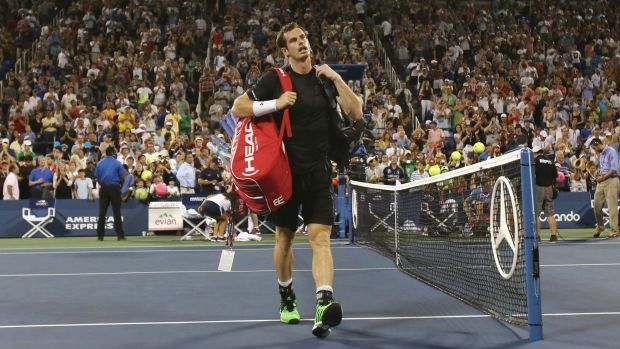 Andy Murray walks off the court after losing in the fourth round of the US Open.