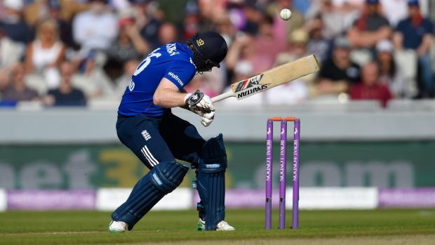 Eoin Morgan is hit on the helmet by a ball from Mitchl Starc.