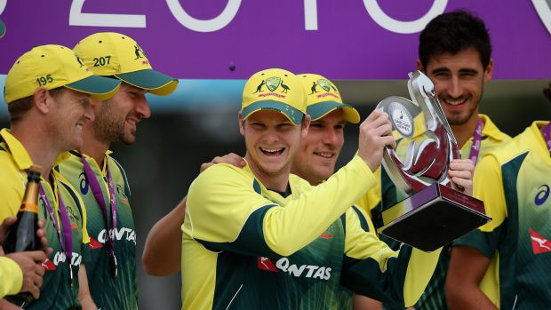 Steve Smith celebrates with his team after claiming the one-day series against England at Old Trafford on Sunday.