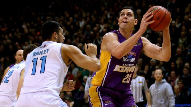 New recruit: Jeromie Hill takes a shot for the Sydney Kings while guarded by Duane Bailey.