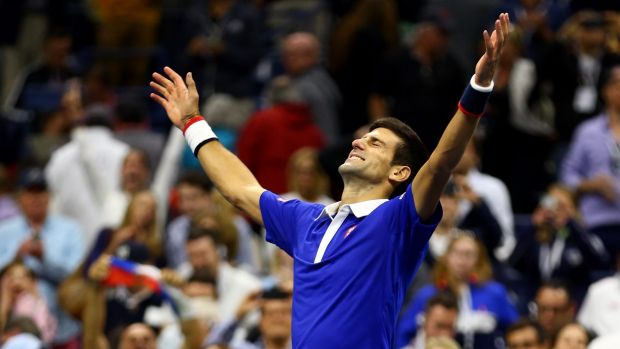 Victory: Novak Djokovic celebrates after defeating Roger Federer to win the 2015 US Open in New York.